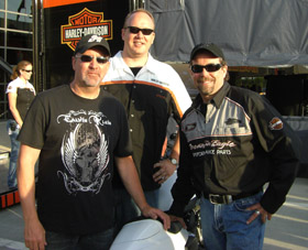 Chris Carr with the owner of Harley-Davidson Motorcycles